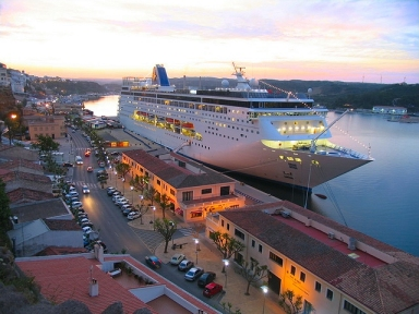 View of the beautiful cruise ship berthed in front of the park Rochina and near the port authority building of Mahon