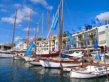 Fa�ade of the building of the club maritime Mahon, and casino gambling, on the docks of the club, the boats are sailing classic involving racing Minorca Panerai